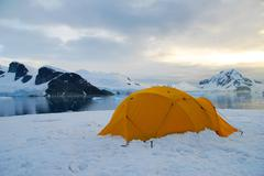 tent in cold polar landscape - stock photo