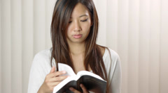 Young Woman Reading The Bible Stock Footage