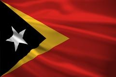 east timor flag blowing in the wind - stock illustration