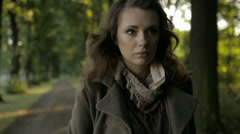 Serious woman in autumn day Stock Footage