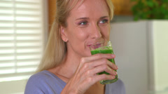 Close up of mature adult woman drinking juice Stock Footage