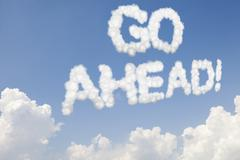 Go ahead concept text in clouds Stock Illustration