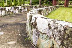 retaining wall  in garden. - stock photo