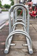bike parking rack ,photo of a bicycle parking rack in bangkok thailand. - stock photo