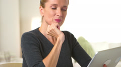 Middle Aged woman using tablet computer Stock Footage