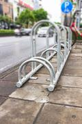 Stock Photo of bike parking rack ,photo of a bicycle parking rack in bangkok thailand.
