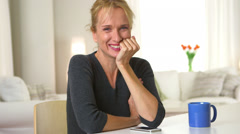 Mature adult woman smiling and talking to camera Stock Footage