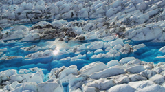 Aerial view glacial ice formations pools ice blue water, Alaska - stock footage
