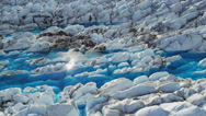 Stock Video Footage of Aerial view glacial ice formations pools ice blue water, Alaska