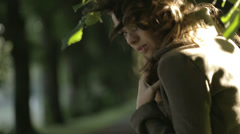 Smart brunette woman in the forest - stock footage