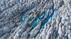 Aerial view moraine affected ice sheets from glacier, Alaska - stock footage