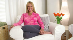 Mature woman smiling in living room - stock footage
