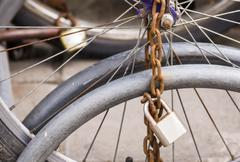 Lock and chain on a bicycle ,close up view of a large lock and chain attached Stock Photos