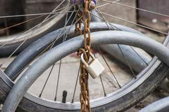 lock and chain on a bicycle ,close up view of a large lock and chain attached - stock photo