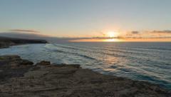 Time lapse sunset la pared beach pan - tilt 11167 Stock Footage