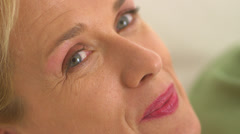 Close up of mature woman smiling - stock footage