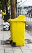 yellow rubbish bin - stock photo