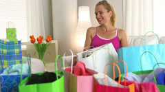Mature woman looking through shopping bags Stock Footage