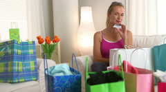 Middle aged woman with debit card and recent purchases - stock footage