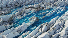 Aerial view moraine affected ice sheets from glacier, USA Stock Footage