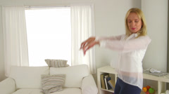 Mature woman dancing in living room Stock Footage