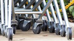 wheel cart,shopping carts wheels closeup - stock photo