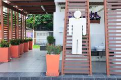 Outside of men public toilet Stock Photos