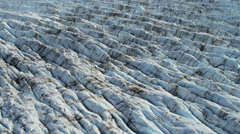 Aerial view glacial ice formations wave like Arctic region - stock footage