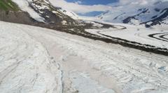 Aerial view of arctic glacier cut between mountain valley, Alaska Stock Footage