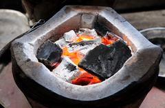 Charcoal-brazier with charcoals fired Stock Photos