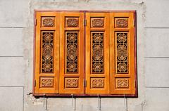 Beautiful chinese wooden windows closed on wall Stock Photos