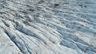 Stock Video Footage of Aerial view glacial ice formations wave like Arctic region