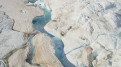Aerial view glacial ice river of ice blue water Arctic region - stock footage