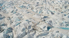 Aerial view glacial ice formations pools ice blue water Arctic region - stock footage