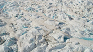 Stock Video Footage of Aerial view glacial ice formations pools ice blue water Arctic region