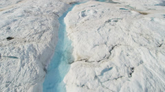 Stock Video Footage of Aerial view glacial ice river of ice blue water Arctic region