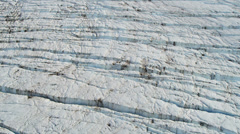 Aerial view glacier constantly moving under its own gravity, Alaska - stock footage