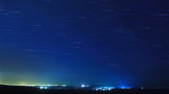 Stars leave traces above the city. Time Lapse Stock Footage