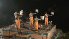 Hindu priest group on river coast performs Ganga Aarti ritual, Varanasi Stock Footage