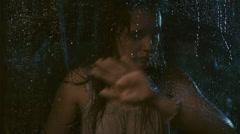 Sad woman in rain - stock footage