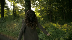 Woman dancing in the forest - stock footage