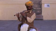 Man plays flute in Mehrangarh Fort, Jodhpur, India Stock Footage