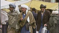 Crowd Marketplace AFGHANISTAN Kabul Men Walk 1980s Vintage Film Home Movie 7165 Stock Footage