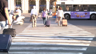 Stock Video Footage of Travellers crossing street.