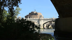 Castle St Angelo seen through arch on Tiber, Rome Stock Footage