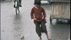 CHILD PLAYS Street Seller Vendor AFGHANISTAN Kabul 1980s Vintage Film Home Movie Stock Footage