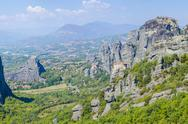 Stock Photo of monastery agias varvaras roussanou on top of rock meteora mountain, greece. i