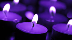 Burning  candles  in a blue tone - stock footage