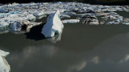 Aerial view Glacial icebergs floating nr main glacier, USA Stock Footage
