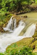 beautiful waterfall in khao laem national park, thailand. - stock photo